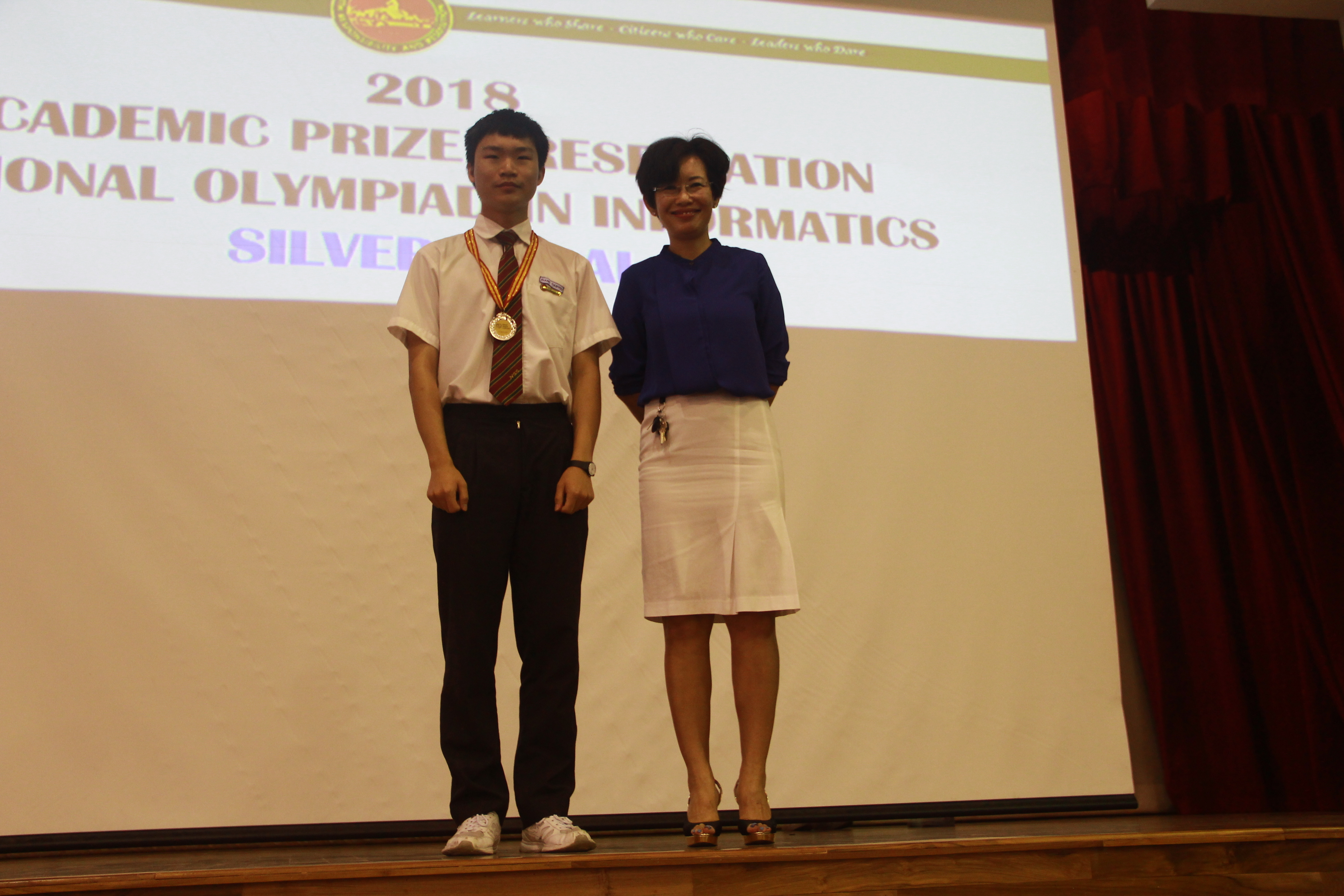 Zhang Tianyou 4R1 receiving his silver medal from Mdm Tan.JPG